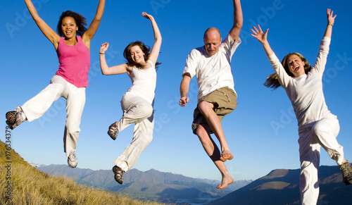 Obraz Group of young people jumping in the field Concept - fototapety do salonu