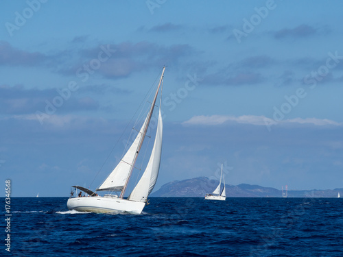 Sailing yacht in Croaatia, windy summer on the boat between rocky islands of the Mediterranean sea