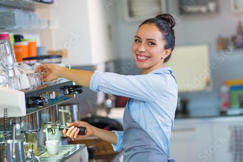 Female barista making coffee Wallpaper Mural