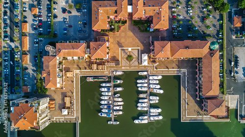 Aluminium Prints Port Aerial view of marina with boats and yachts on port of modern residential district from above