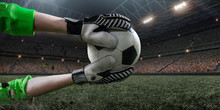 Soccer Goalkeeper Catches A Ball On Big Professional Football Arena. Goalkeeper Wears Unbranded Sport Uniform.
