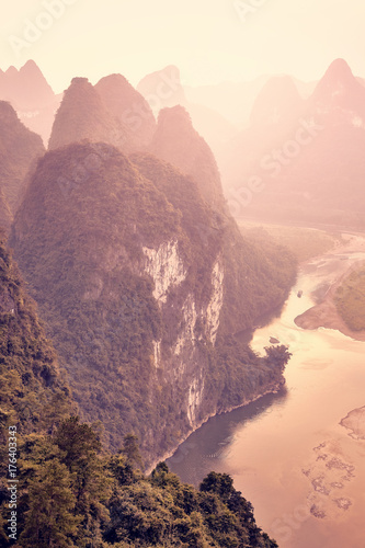 Photo  Li River at sunset seen from Lao Zhai Shan, color toning applied, Xingping, China