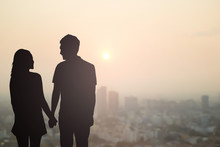 Black Silhouette Of Couples Lover Holding Hand And Looking Each Other On Blurred Beautiful Sunset Sky City Downtown,honeymoon Concept