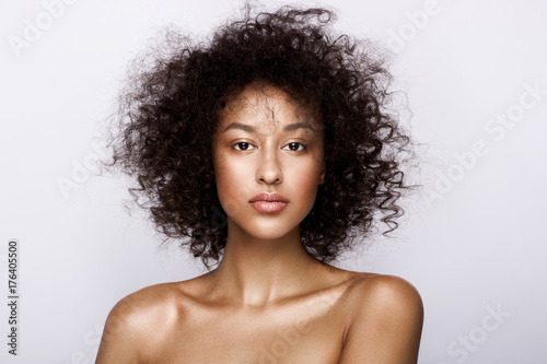 Fotografiet  Fashion studio portrait of beautiful african american woman with perfect smooth