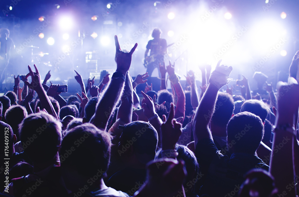 Fototapety, obrazy: Concert Crowd. Silhouettes young people in front of bright stage lights. Band of rock stars