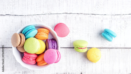Aluminium Prints Macarons Top view flat lay Vibrant colorfull macarons on white wooden table. Text space