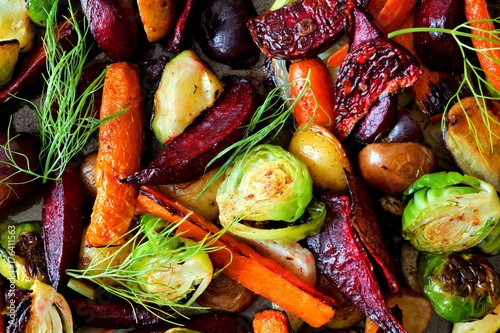 Keuken foto achterwand Groenten Full background of roasted colorful autumn vegetables, above view