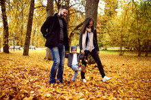 Happy Family In Autumn City Park