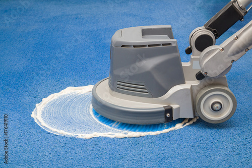 Blue carpet chemical foaming, rubbing and cleaning with professionally disk machine Canvas Print