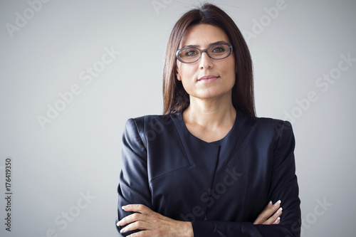 Portrait of businesswoman on grey background Canvas Print