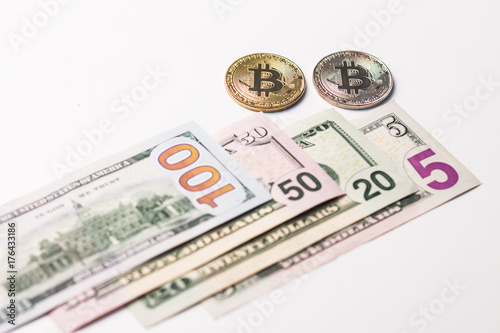 Photo  One hundred and seventy five dollars a usa and two coins of crypto currency on a white background