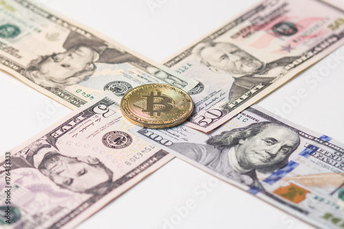 5, 20, 50 and 100 US dollars laid out with a cross with gold bitcoin in the center Poster
