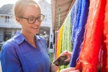 Blonde Woman Looking At Thai Silk