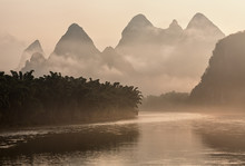 Lijang River And Karst Mountains In China On A Foggy Morning At Sunrise.