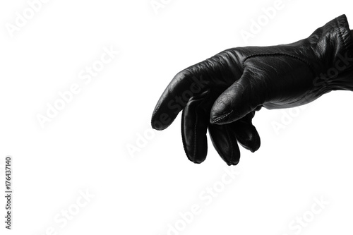 Fotografija  Black glove on white background