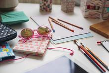Sunglasses On A Girl's Desk