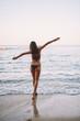 happy woman running around the shore