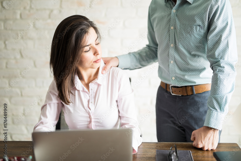 Fototapety, obrazy: Man harrasing a woman at work