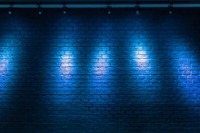 Blue Brick Wall Background With Light Bulb