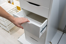 Woman Hand Pulling A Drawer Of...