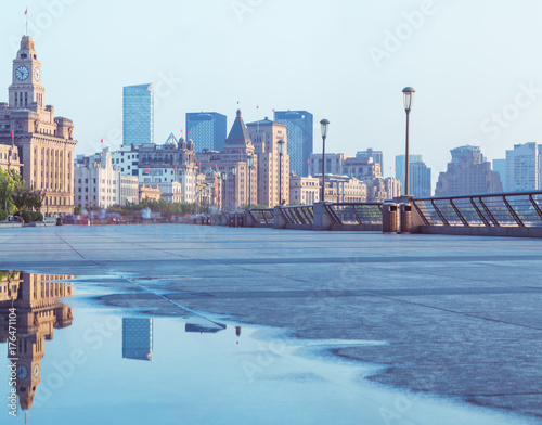 Staande foto Abu Dhabi the bund skyline reflected in water puddle,shanghai,china.