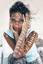 Attractive Young Woman Outdoors Portrait With Tropical Shadows