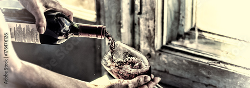 Fototapeta toned. Pouring wine on a old background