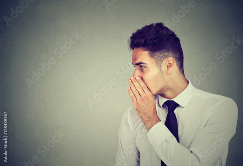 Business man whispering a gossip secret to someone Canvas Print