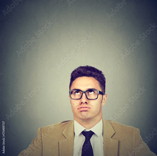 Fotografie, Obraz  Bored annoyed young business man looking up