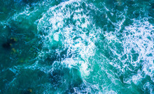 Drone View Of Waves Hitting Sea Shore