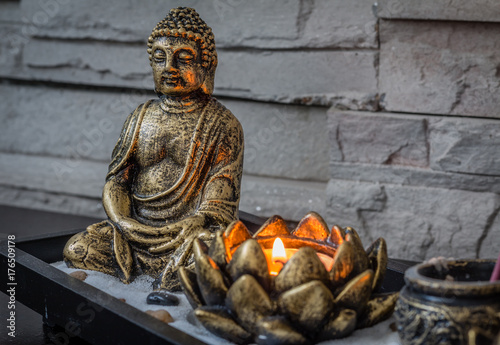 Poster Spa Mini, desk zen garden with lit candle and small Buddha in it