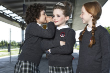 Three Girls At Platform Wearing School Uniform
