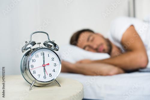Photo alarm clock on bedside table