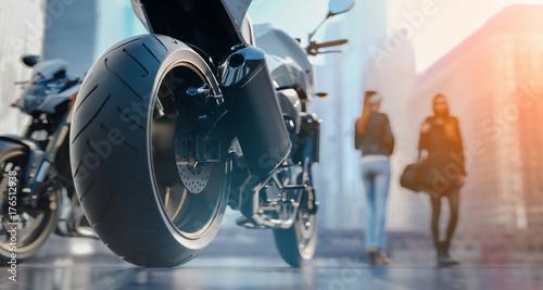 Fototapeta Koła motocyklowe W mieście jest kobieta.