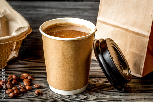 coffee cup to go at wooden background