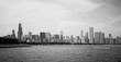 Modern architecture and urban life background.Cityscape with cloudy sky over Chicago downtown skyline, lake Michigan marina. Chicago, Illinois, Midwest USA. Black and white horizontal composition.