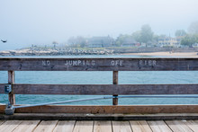 """A Sign On A Pier That Reads No Jumping Off Pier """""""" Sign On A Pier That """""""""""" Sign On A Pier That Read"""""""