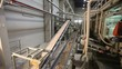 Сonveyor belt on factory, Ceramic factory equipment, Transportation of clay on the conveyor, industrial interior, Transportation of raw materials on the conveyor