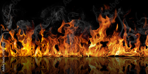 Door stickers Fire / Flame The texture of fire on a black background is reflected in a glossy table.