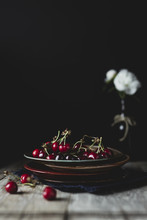 Cherries And Flower On The Table