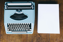 Blue Typewriter With A Ream Of...