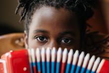 African American Girl Playing An Accordion