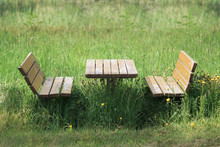 Benches And Table In Green Meadow