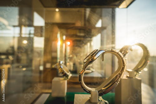 Sun ray on luxury watches displayed in shopwindow