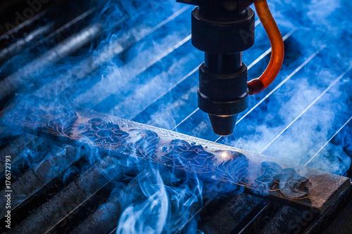 Fototapeta Laser makes engraving on leather belt  obraz