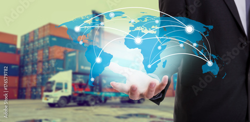 Cuadros en Lienzo Global network coverage world map on hand of businessman ,Industrial Container C