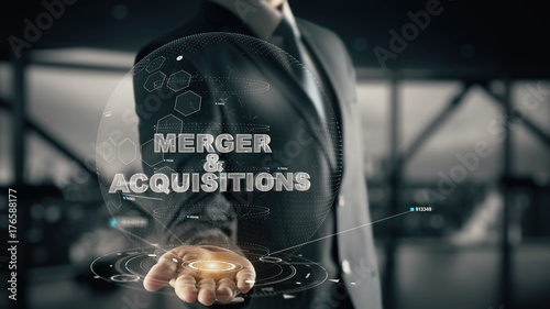 Fotografie, Obraz  Merger & Acquisitions with hologram businessman concept