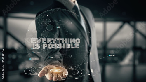 Fotografía  Everything is Possible with hologram businessman concept