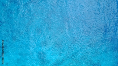 P02679 Aerial flying drone view of Maldives white sandy beach abstract waves water surface texture on sunny tropical paradise island with aqua blue sky sea ocean 4k