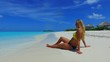 P02717 Maldives white sandy beach 1 person young beautiful woman relaxing on sunny tropical paradise island with aqua blue sky sea water ocean 4k
